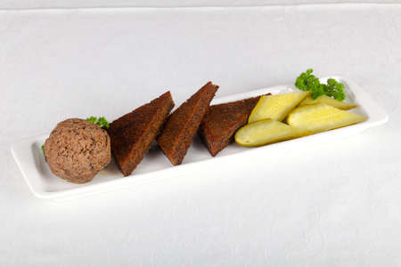 Liver spread with bread and pickled cucumbers Stock Photo