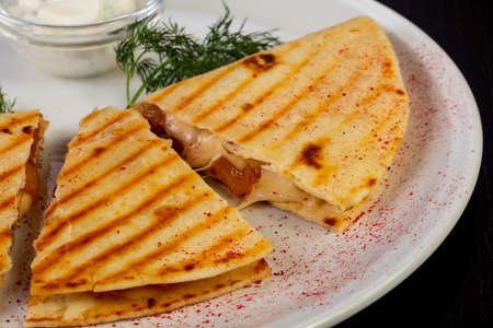 Tasty mexican quesadilla with chicken