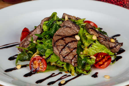 Tasty stake salad with vegetables