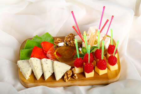 Cheese plate assortment with raspberry