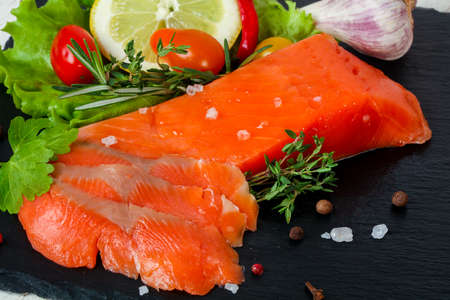 Raw trout fillet with salt and spices