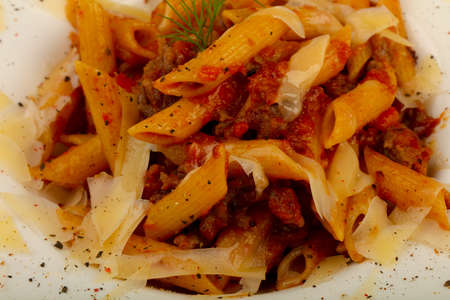 Penne bolognese with parmesan cheese