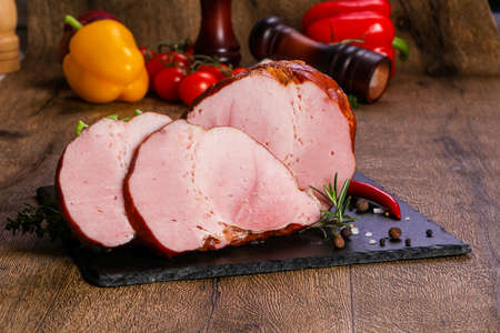 Smoked pork meat over the wooden background Stockfoto