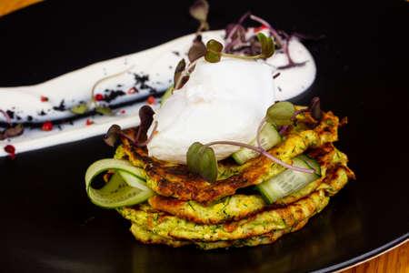Zucchini pancake with cream and herbs