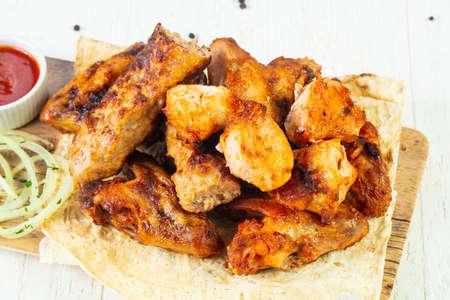 Meat kebab mix plate - chicken wings, pork, beef