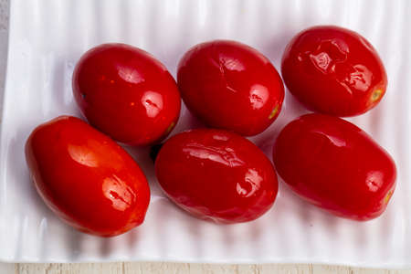 Tasty healthy pickled red tomatoes