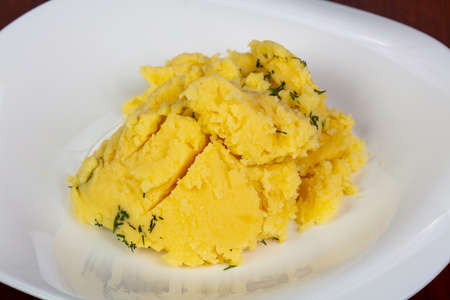 Mushed potato with dill in the plate Stock Photo