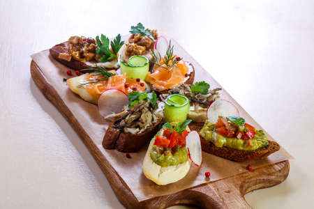Spanish bruschetta mix with fish and vegetables