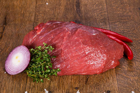 Raw beef meat over the wooden background Stock Photo