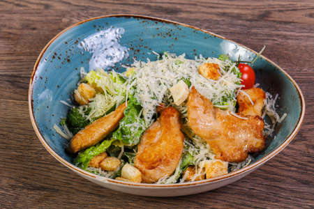 Caesar salad with chicken and parmesan cheese Imagens