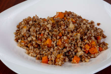 Buckwheat with vegetables in the plate