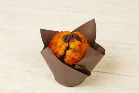 Sweet tasty muffin with jam Фото со стока