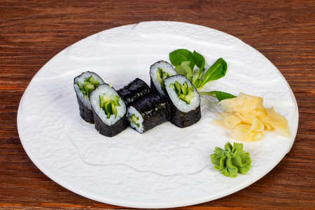Japanese roll with cucumber served ginger