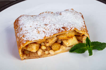 Delicious Apple strudel with powedered sugar and peppermint Stockfoto