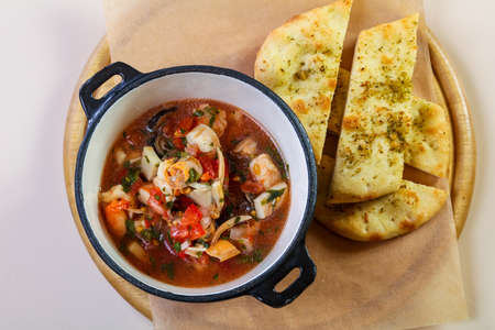 Seafood soup with bread and spices Stock Photo