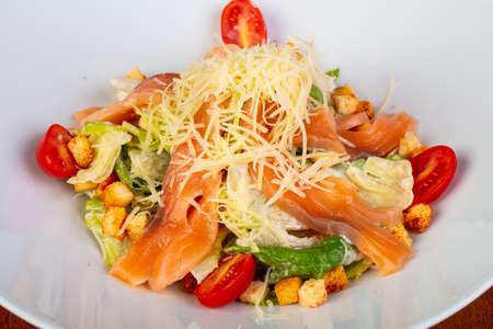 Tasty salmon Caesar salad with tomatoes