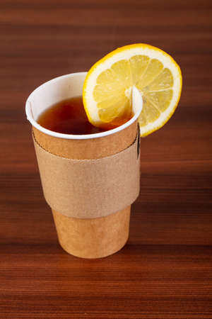 Cup of tea with lemon over wooden background Stock Photo