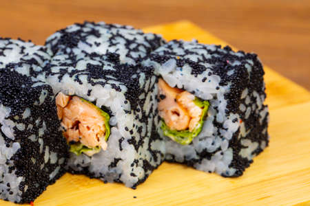 Delicious sushi rolls with black caviar