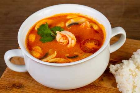 Thai Tom Yam soup with steamed rice Stock Photo