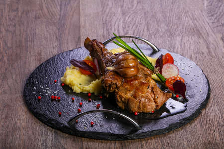Lamb with mashed potato served vegetables