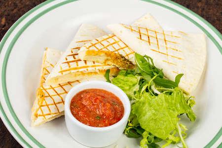 Delicious quesadilla pita with chili sauce