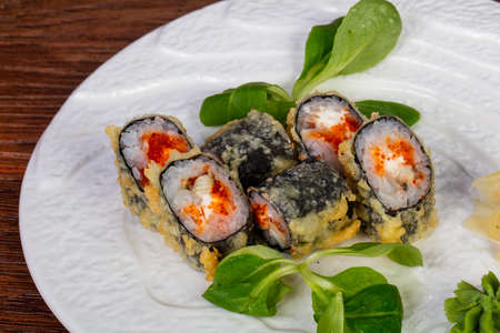 Tempura roll with eel and tobiko