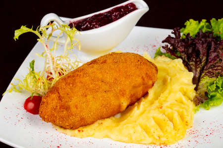 Chicken Kiev cutlet with mashed potato 写真素材 - 108434396
