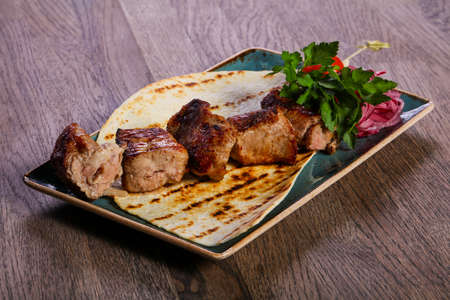 Pork kebab barbeque served herbs and bread