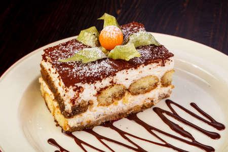 Famous Tiramisu cake served chokolate Фото со стока