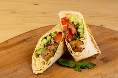 Shawarma with falafel and vegetables Stock Photo