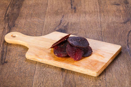 Dried beef meat over wooden board
