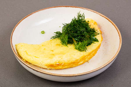 Omelet with dill in the bowl