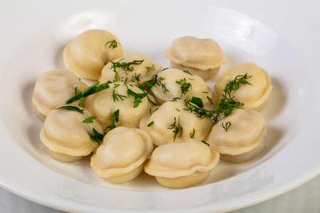 Homemade Russian dumplings with dill Stock Photo