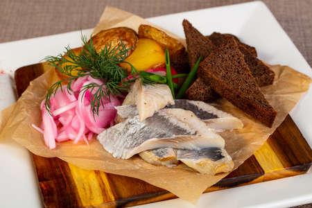 Sliced herring fillet with potato