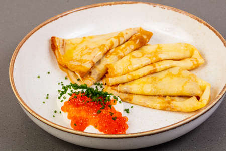 Pancakes with red caviar and dill Stock Photo