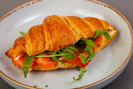 Croissant with salmon and rucola