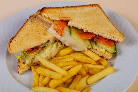Sandwich with salmon and fries potato Stock Photo