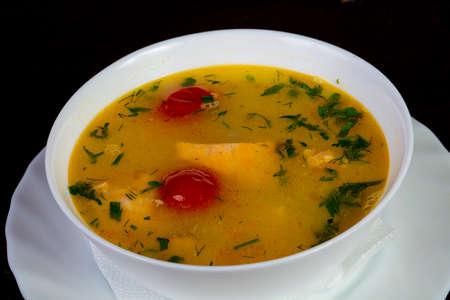 Fish soup with salmon and tomato - Uha Stock Photo