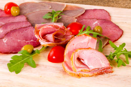 Sausages and ham assortment with sauce