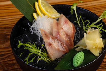 Cold yellowtail sashimi served lemon