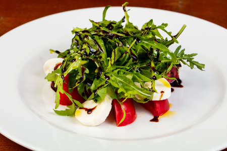 Salad with mozzarella, tomato and rucola