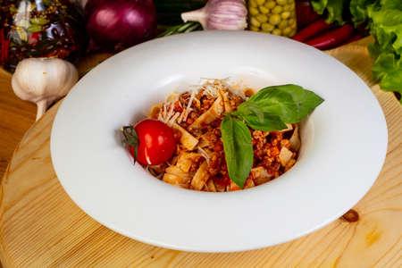 Italian spaghetti bolognese with basil