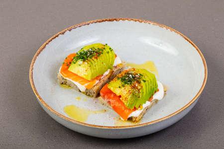 Bruschetta with salmon, cream and avocado