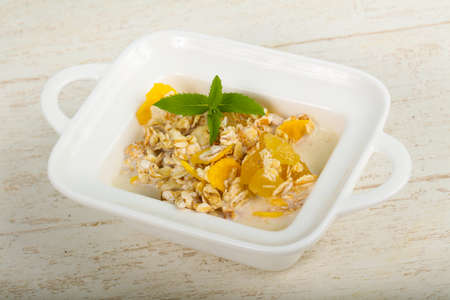 Muesli with banana, nuts and mint