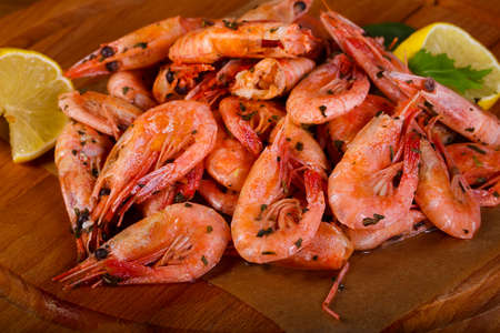 Boiled shrimps with lemon and herbs