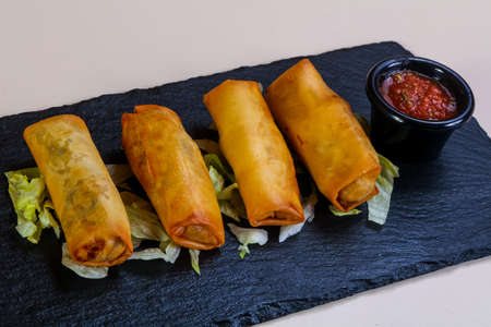 Spring roll with tomato sauce Stock Photo