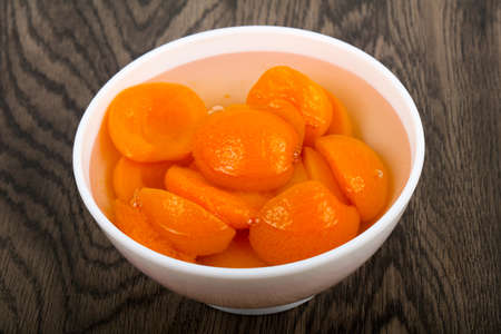 Canned apricots with mint leaves