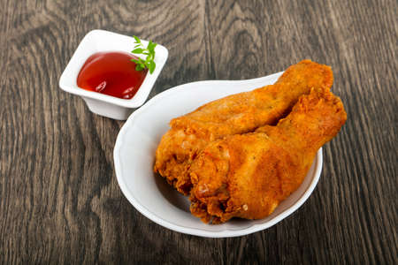 Crispy chicken legs with  ketchup