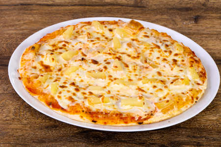 Pineapple pizza with soft cheese 免版税图像