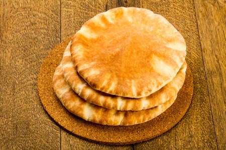 Pita bread heap over the wooden background Stock Photo